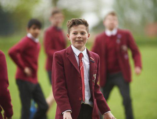 boy in Edge Grove School uniform