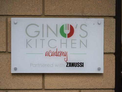 Ginos kitchen academy sign